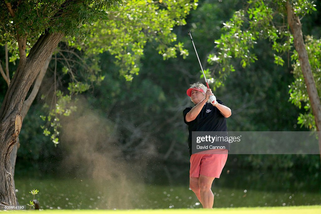 Laura Davies of England plays her second shot on teh par 4 second hole during the third round of the 2015 Omega Dubai Ladies Masters on the Majlis...
