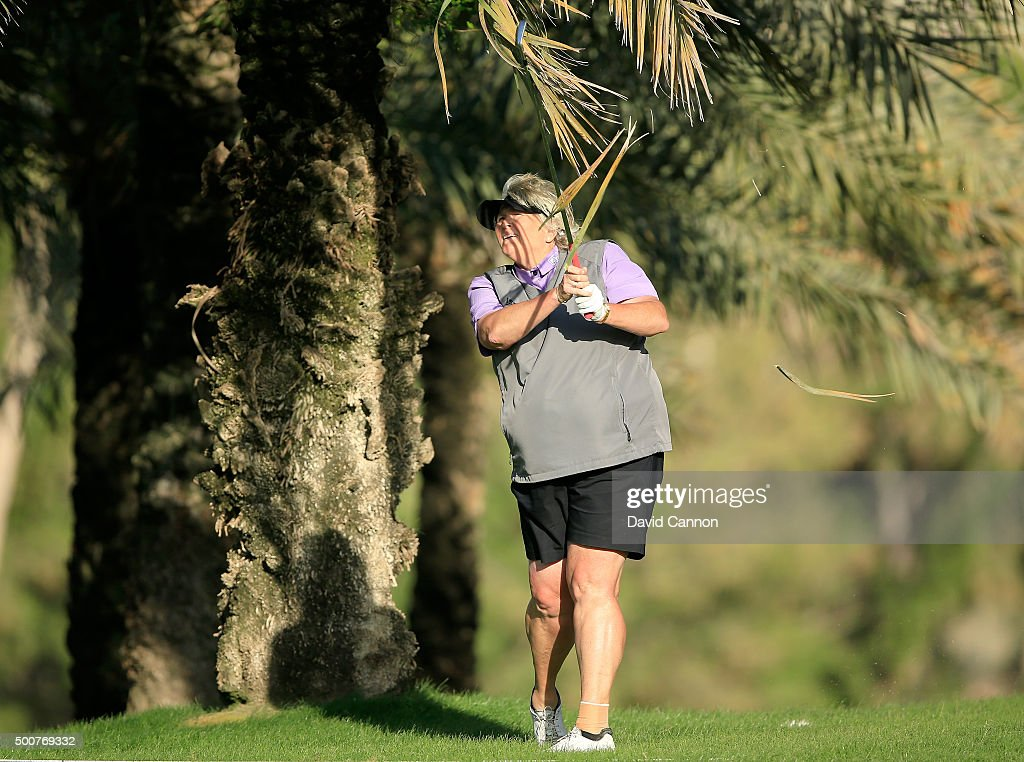 Laura Davies of England plays her second shot on the par 5 18th hole during the second round of the 2015 Omega Dubai Ladies Masters on the Majlis...