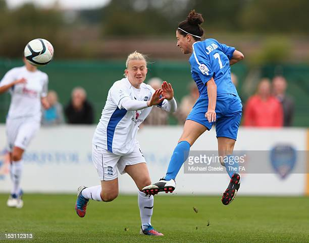 Laura Del Rio of Bristol Academy Women's FC heads goalwards as Laura Bassett of Birmingham City Ladies FC looks on during the FA WSL match between...
