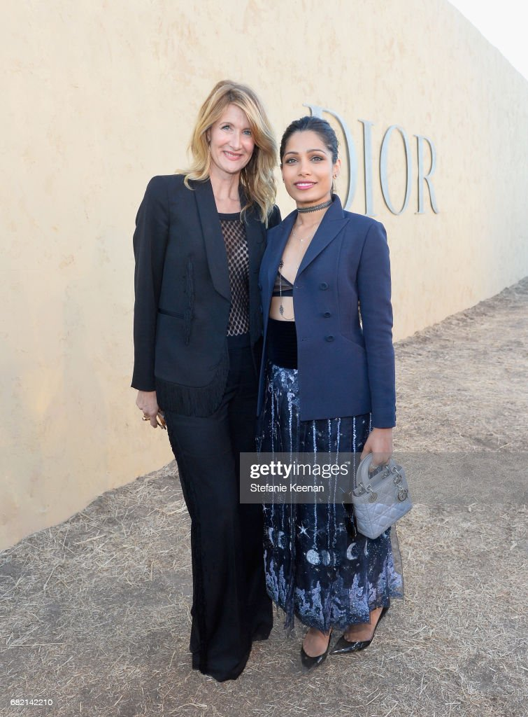 Laura Dern and Freida Pinto at Christian Dior Cruise 2018 Show and After Party at Gladstone's Malibu on May 11, 2017 in Malibu, California.