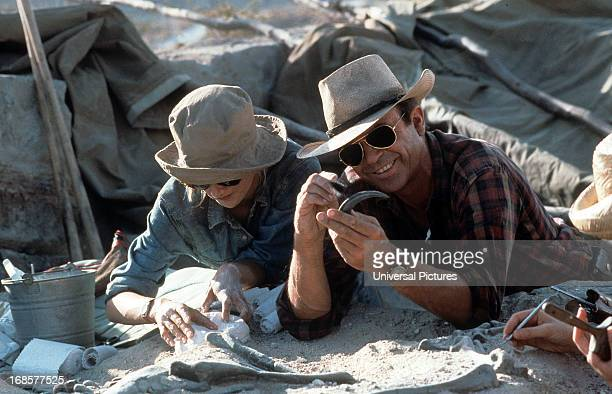 Laura Dern and Sam Neill dig for fossils in a scene from the film 'Jurassic Park' 1993