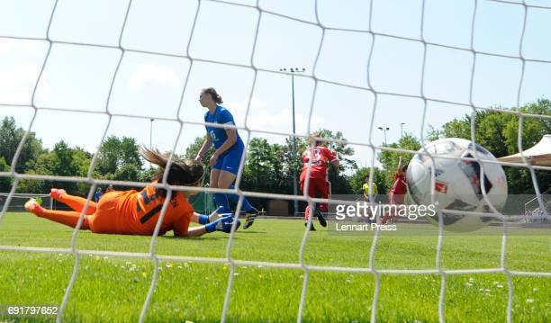 Laura Donhauser of FC Bayern Muenchen scores her sides's third goal against Julia Kassen of SV Meppen during the B Junior Girl's German Championship...