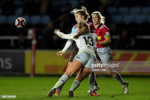 Laura Dowsett of Harlequins is tackled by Cara Wardle of Saracens during the Tyrrells Premier 15s match between Harlequins Ladies and Saracens Women...