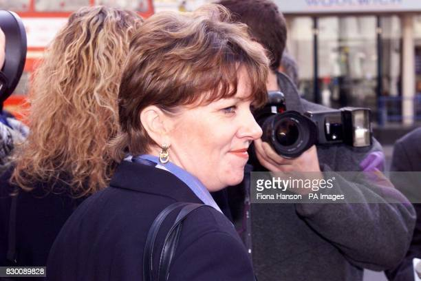 Laura Dyer a former undercover detective with the Metropolitan Police leaves the High Court in London Monday October 26 1998 after being awarded...