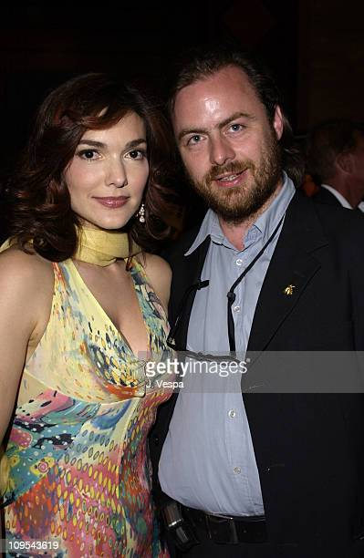 Laura Elena Harring and Paul Hills during 2003 Cannes Film Festival Roberto Cavalli Fashion Show Dinner at Palm Beach in Cannes France
