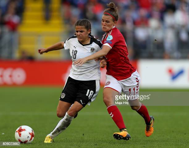 Laura Feiersinger of Austria holds off pressure from Katrine Veje of Denmark during the UEFA Women's Euro 2017 Semi Final match between Denmark and...