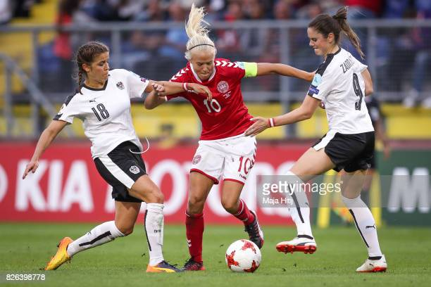 Laura Feiersinger of Austria Pernille Harder of Denmark and Sarah Zadrazil of Austria battle for the ball during the UEFA Women's Euro 2017 Semi...