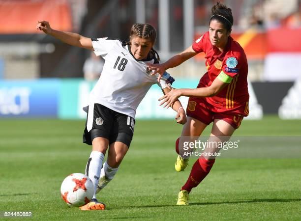 Laura Feiersinger of Austria vies with Marta Torrejon of Spain during the UEFA Womens Euro 2017 quarterfinals football match between Austria and...