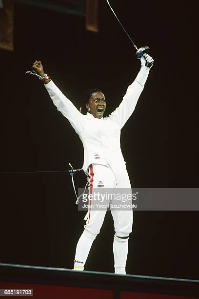 Laura Flessel from France celebrates victory in the women's individual epee event at the 1996 Summer Olympics