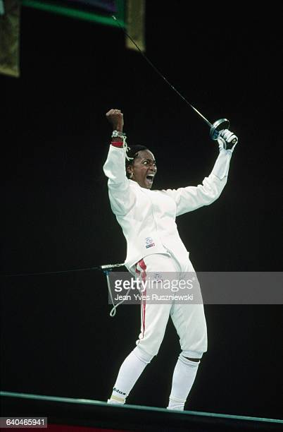 Laura Flessel smiles and clenches her fist after winning the gold medal in fencing at the 1996 Atlanta Olympic Games