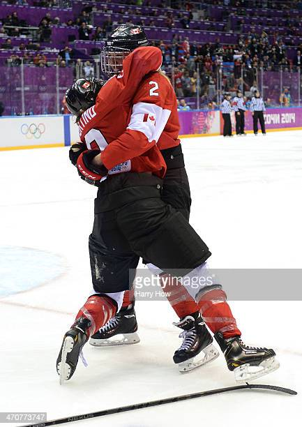 Laura Fortino hugs Meghan AgostaMarciano of Canada after defeating the United States 32 in overtime during the Ice Hockey Women's Gold Medal Game on...
