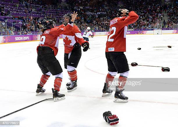 Laura Fortino Meghan AgostaMarciano and Hayley Wickenheiser of Canada celebrate after defeating the United States 32 in overtime during the Ice...