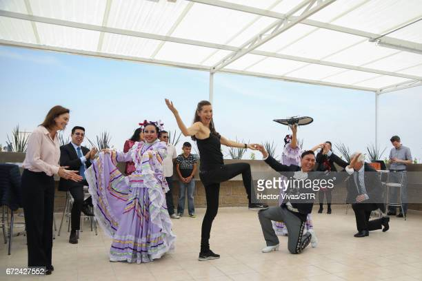 Laura Franco President of Laureles Foundation and Klara Bierhoff dance with mexican folkloric dancers during the visit and unveiling of plaque for...