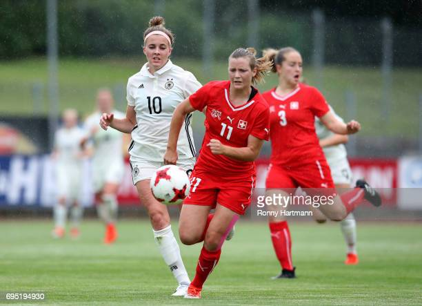 Laura Freigang of Germany and Nathalie Lienhard of Switzerland compete during the U19 women's elite round match between Germany and Switzerland at...