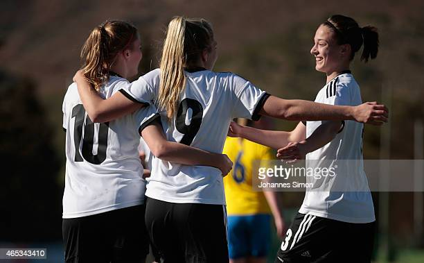 Laura Freigang of Germany celebrates after scoring her team's 2nd goal with team mate Nina Ehegoetz and Felicitas Rauch during the women's U19...