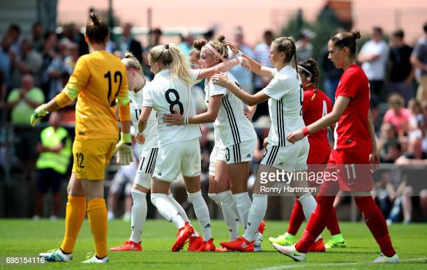 Laura Freigang of Germany celebrates after scoring her team's fourth goal with team mates during the U19 women's elite round match between Poland and...