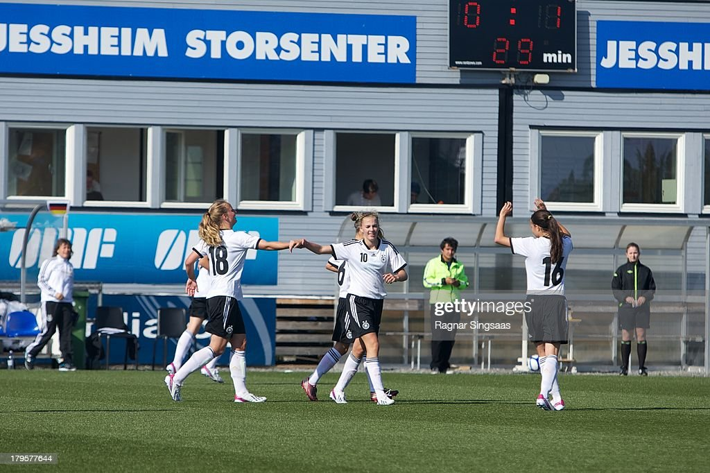 Laura Freigang of Germany celebrates with team-mates after scoring the opening goal during the Girls Friendly match between Norway U16 and Germany U16 at the UKI Arena on September 5, 2013 in Jessheim, Norway.