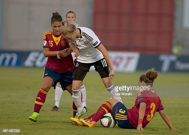 Laura Freigang of Germany challenges Sandra Hernandez of Spain during the UEFA Women's Under19 European Championship group stage match between U19...