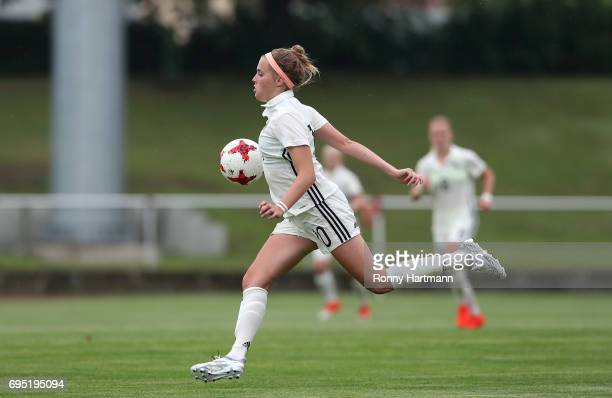 Laura Freigang of Germany runs with the ball during the U19 women's elite round match between Germany and Switzerland at Friedensstadion on June 9...