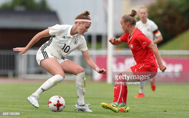 Laura Freigang of Germany vies with Celine von Potobsky of Switzerland during the U19 women's elite round match between Germany and Switzerland at...