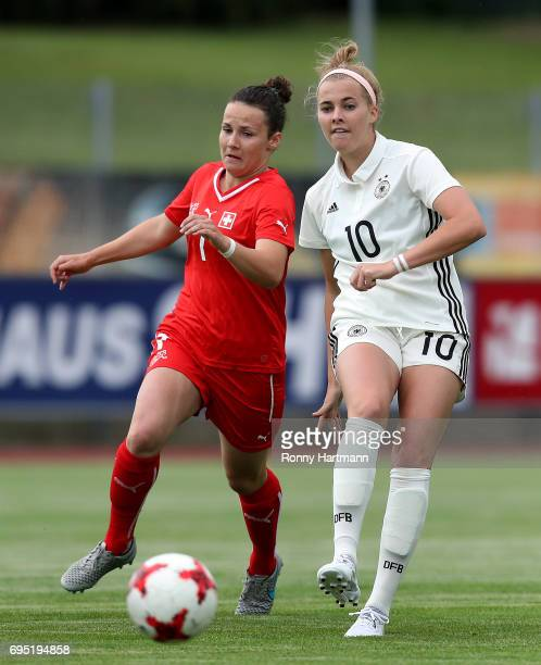 Laura Freigang of Germany vies with Thais Hurni of Switzerland during the U19 women's elite round match between Germany and Switzerland at...