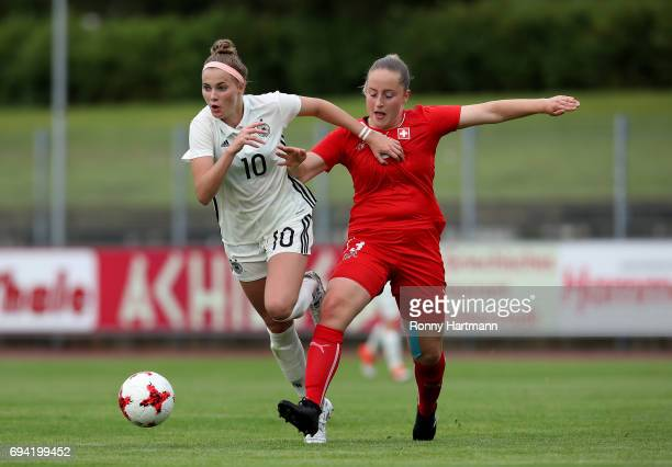 Laura Freigang of Germany vies with Yara Hofmann of Switzerland during the U19 women's elite round match between Germany and Switzerland at...