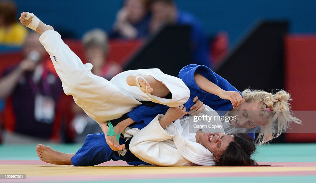 Laura Garcia Benitez of Spain competes against Yuliya Halinska of Ukraine during the Women's -48 kg Judo quarter final on day 1 of the London 2012 Paralympic Games at ExCel on August 30, 2012 in London, England.