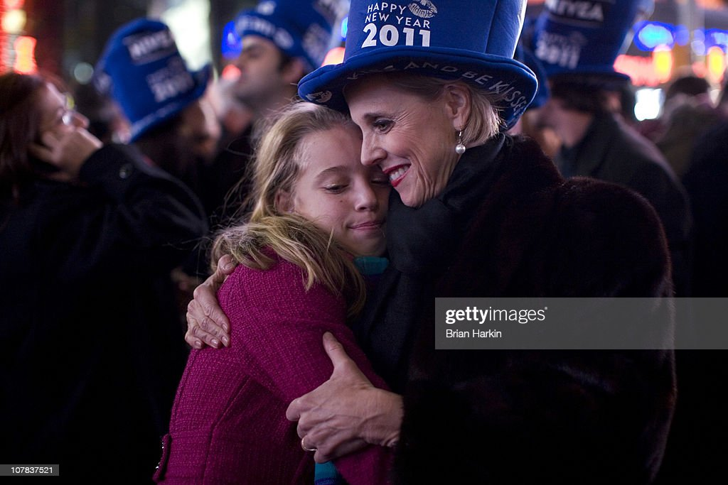 Laura Geiger (R) hugs her daughter Livia Lanier Geiger, 10, both of Barnesville, Georgia in Times Square just after the annual ball drop January 01, 2011 in New York City. This year a 11,875-pound Waterford crystal ball descended a 141-foot tall flagpole to mark the beginning of 2011.