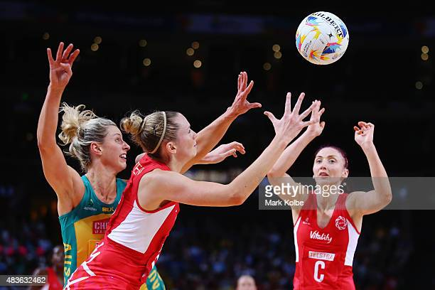 Laura Geitz Of Australia competes for the ball with Joanne Harten of England as she catches a pass from Jade Clarke of England during the 2015...