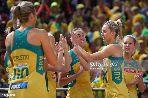 Laura Geitz of Australia high fives her team mates as she take the court during the 2015 Netball World Cup Qualification round match between...