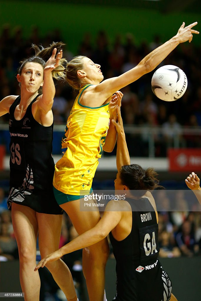 Laura Geitz of Australia reaches out under pressure from Bailey Mes and Jodi Brown of New Zealand during the International Test match between the New...