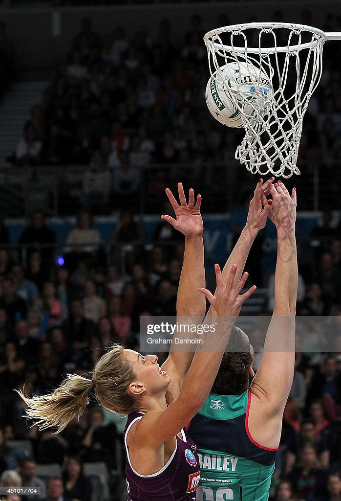 Laura Geitz of the Firebirds and Karyn Bailey of the Vixens compete for the ball during the ANZ Championship Grand Final match between the Vixens and...