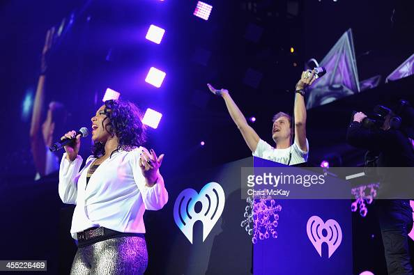 Laura Givens performs with Armin van Buuren onstage during Power 961's Jingle Ball 2013 at Philips Arena on December 11 2013 in Atlanta Georgia
