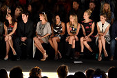 Laura Gomez RJ Mitte Rosario Dawson Camille Rowe Poppy Delevingne and Olivia Palermo sit front row at the Desigual fashion show during MercedesBenz...