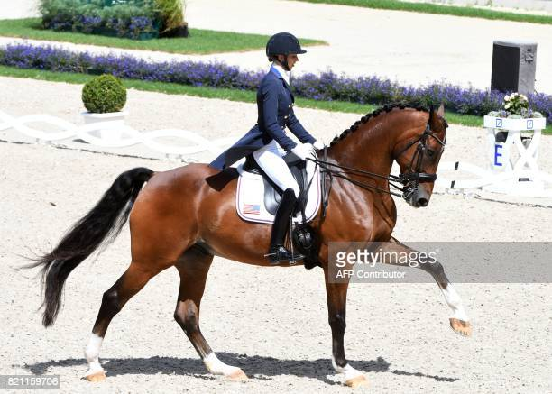 Laura Graves of the US on her horse Verdades competes in the Grand Prix Freestyle CDIO during the World Equestrian Festival CHIO in Aachen Germany on...