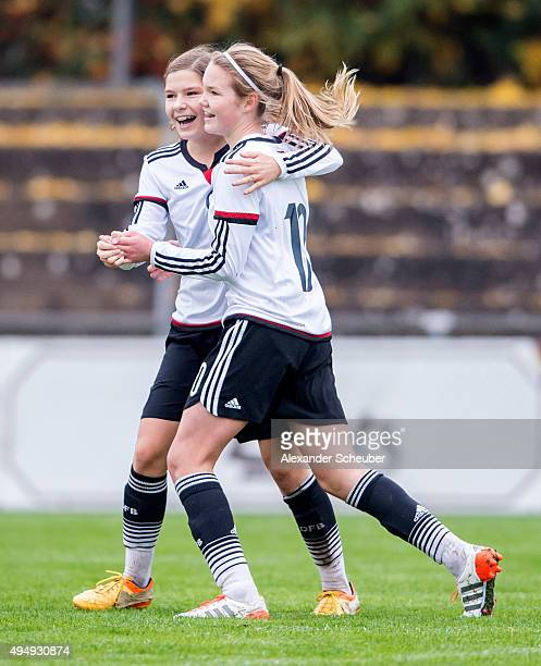Laura Haas of Germany celebrates the first goal for her team with Pauline Berning of Germany during the international friendly match between U15...