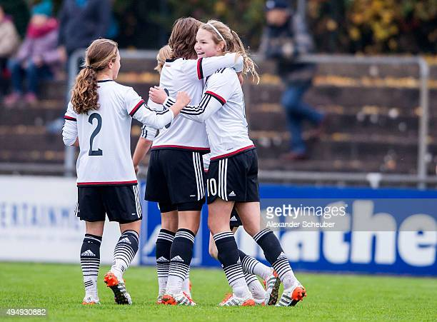 Laura Haas of Germany celebrates the first goal for her team with Lena Sophie Oberdorf of Germany and AliciaSophie Gudorf of Germany during the...