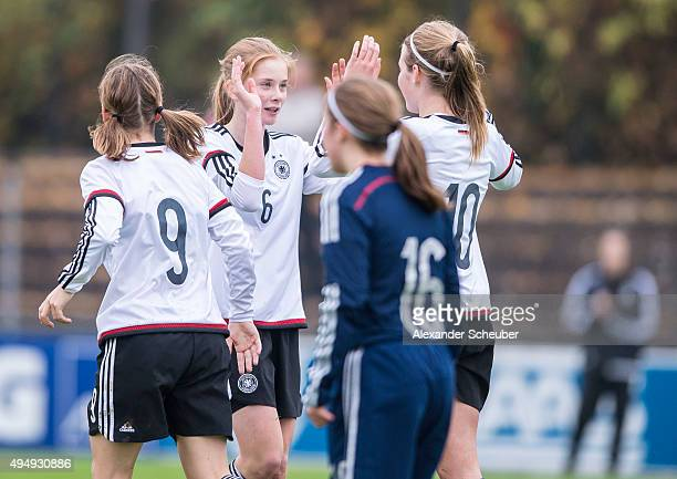 Laura Haas of Germany celebrates the third goal for her team with Sjoeke Nuesken of Germany during the international friendly match between U15...