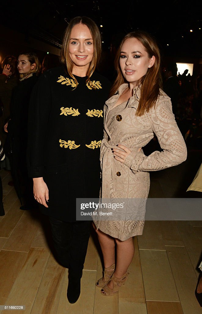 Laura Haddock (L) and Tanya Burr wearing Burberry at the Burberry Womenswear February 2016 Show at Kensington Gardens on February 22, 2016 in London, England.