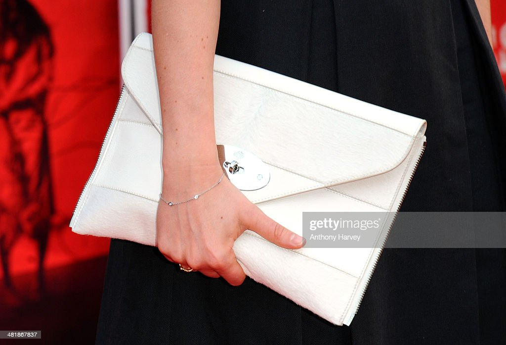 Laura Haddock (Bag Detail) attends the World Premiere of 'The Quiet Ones' at Odeon West End on April 1, 2014 in London, England.