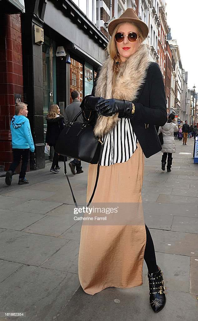 Laura Harby, dancer wearing a black Zara jacket, two tone black and white stripe Zara blouse over beige Maxi Zara skirt, accessorised with a H & M stole, black leather gloves from New York and Top Shop sunglasses with diamente studded detail at London Fashion Week Fall/Winter 2013/14 on February 17, 2013 in London, England.