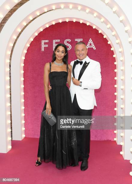 Laura Harrier and CEO of BVLGARI JeanChristophe Babin attend Bvlgari Party at Scuola Grande della Misericordia on June 30 2017 in Venice Italy