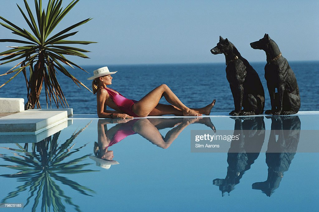 Laura Hawk assistant to the photographer relaxes by the pool at El Rincon the von Pantz' Marbella home September 1985
