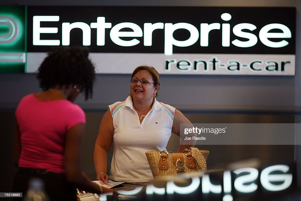 Laura Henley picks up a vehicle at Enterprise rent-a-car at the Fort Lauderdale/Hollywood International airport July 10, 2007 in Fort Lauderdale, Florida. Pending regulatory approval, expected in the next month, Enterprise will buy National and Alamo rental car companies. Enterprise would make an instant jump from about 8% of the airport car rental market market to more than 27% just behind Hertz's 28.5%.