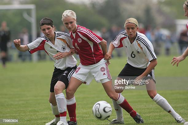 Laura Hoffmann of Germany Isabella M MPetersen of Denmark and Michelle Baumann of Germany battle for the ball during the women's Under 17...