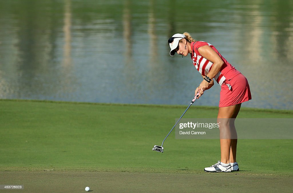 Laura Jansone of Latvia putting at the par 4, fifth hole during the second round of the 2013 Omega Dubai Ladies Masters on the Majilis Course at the Emirates Golf Club on December 5, 2013 in Dubai, United Arab Emirates.