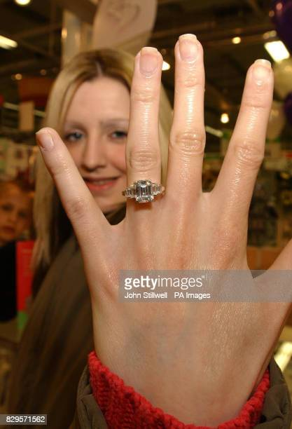 Laura Jones aged 20 from Bermondsey South London tries on an engagemnt ring that is a copy of the ring that the Prince of Wales gave to Mrs Camilla...