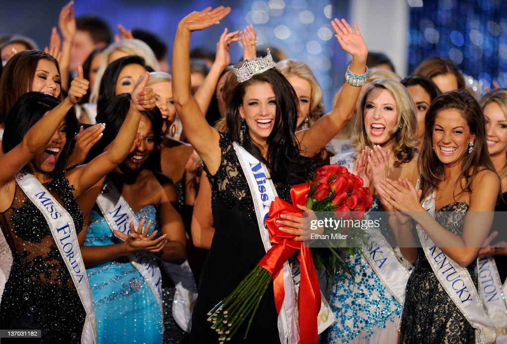 Laura Kaeppeler (C), Miss Wisconsin, is surrounded by fellow contestants after being crowned Miss America during the 2012 Miss America Pageant at the Planet Hollywood Resort & Casino January 14, 2012 in Las Vegas, Nevada.