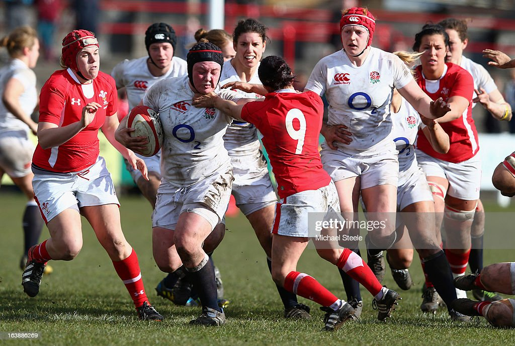 Laura Keates (2nd L) of England holds off Amy Day (#9) of Wales during the Wales v England Womens Six Nations match at the Talbot Athletic Ground on March 17, 2013 in Port Talbot, Wales.