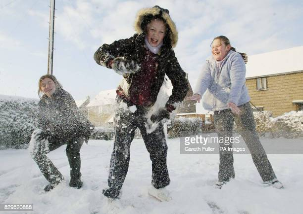 Laura King Michelle King 12 and Jessica McPhee 11 enjoy the thick snow in Great Chart Kent after heavy snow showers last night